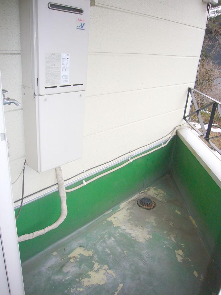バルコニーに洗濯機置き場